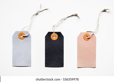 Blank price sale tag tied with string. address label