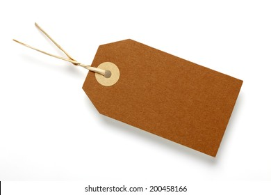 Blank price tag on white surface with soft shadow