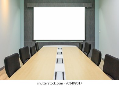 Blank projection screen in meeting room with conference table, Modern meeting room interior background