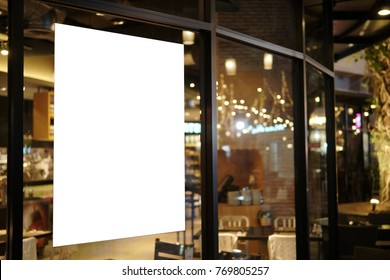 Blank promotion poster display on glass window at restaurant or cafe,promotion information for announcement message successful marketing