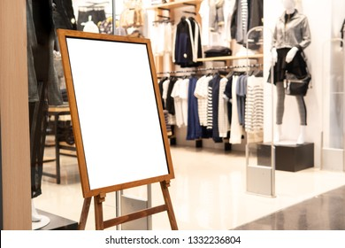 Blank promotion poster display stand at clothes shop or storefront.Promotion information for announcement message successful marketing.