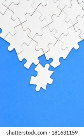 Blank puzzle on blue background