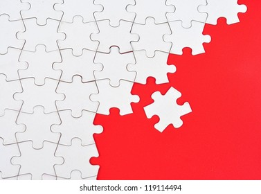 Blank puzzle on red background