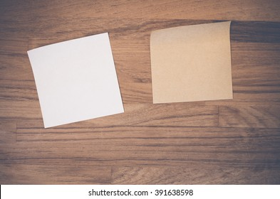 blank recycled paper memos on a wood textured surface - abstract backgounds - copy space