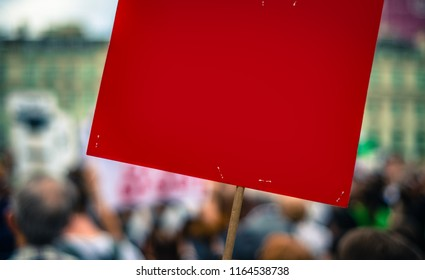 A Blank Red Sign For Your Text At A Street Rally Or Protest Or March