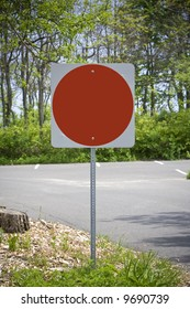Blank red stop sign in car park