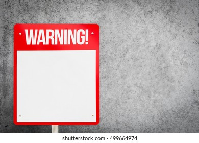 Blank red warning sign on gray concrete background.