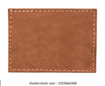 blank reddish-brown leather label isolated on white