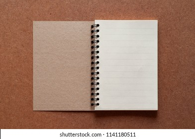 Blank retro notebook paper on wood