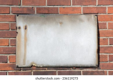 blank retro rusty metal sign on brick wall