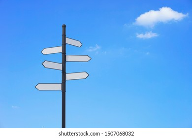 Blank Road Sign arrows, blue sky cloud white weather