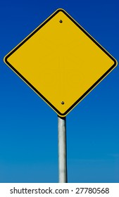 A blank road sign isolated on a blue graduated sky.