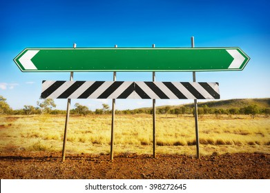 A blank road sign pointing in opposite directions with room for your own text.
