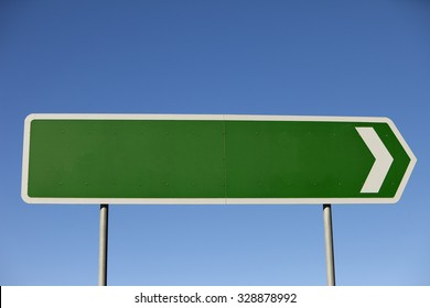 A blank road sign set against perfect blue sky pointing to right of frame, flip image to point to left, lots of copy space inside and outside of the sign.  Shot with a Canon 5d mk2 in rural Australia.