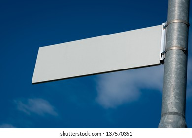 Blank Road Sign with sky and clouds.