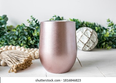 Blank rose gold insulated sublimation wine tumbler, farmhouse style background, drinkware mockup