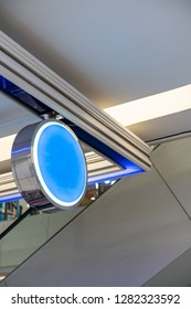 Blank round signboard hanging from ceiling  Interior design detail.