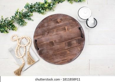 Blank rustic round wood serving tray on white background, famrmhouse style kitchen decor mockup