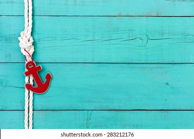 Blank rustic teal blue wooden nautical sign with red anchor and white rope border