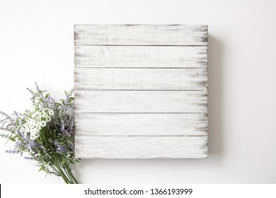 Blank rustic white wood sign with flower decor, mock up