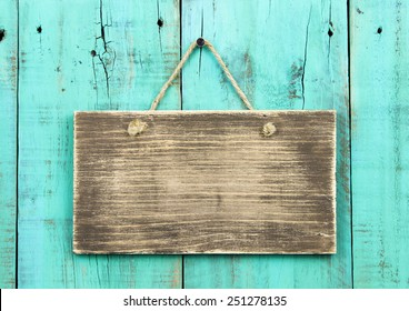 Blank Rustic Wooden Sign Hanging On Washed Out Teal Blue Distressed Antique Wood Background Color