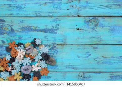 Blank rustic wooden teal blue sign with colorful floral and hope, faith, love stones border