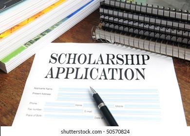 blank scholarship  application on desktop with books