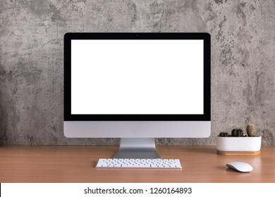 Blank screen of all in one computer with cactus vase on raw concreate background