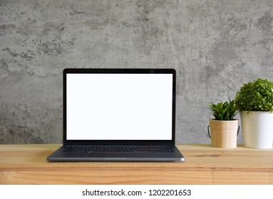 blank screen laptop computer on work table front view in loft room style