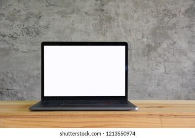 Blank screen Laptop on wooden table in room Loft style