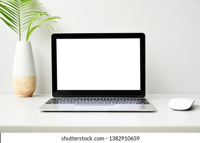 blank screen Modern laptop computer with mouse,Smart phone on wood table in office view backgrounds