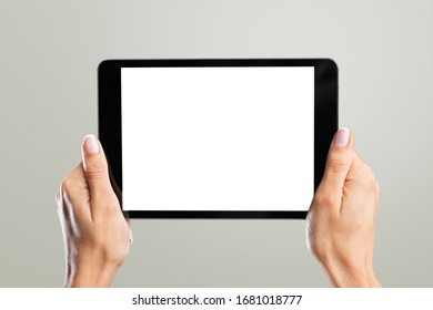 Blank screen on a digital tablet in human hands
