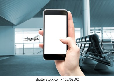 Blank screen smartphone with space for copy at the airport, filtered and digitally modified.
