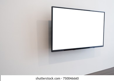 blank screen television on concrete wall at living room. copy space for text on TV.
