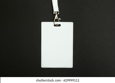 Blank Security Tag with Neck Band Isolated on Black Background.