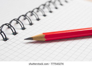 Blank sheet of notebook with pencil.