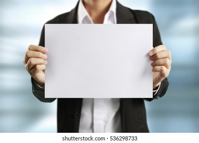 blank sheet of paper in businessman hand