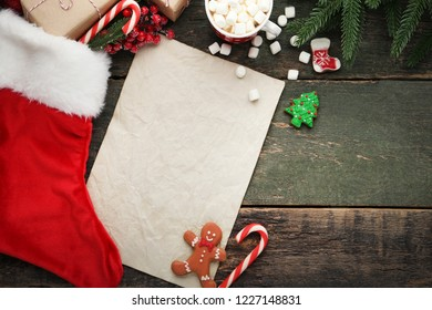 Blank sheet of paper with christmas stocking and cup of coffee