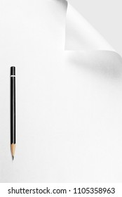 Blank sheet of paper with curled corner and pencil