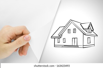 Blank sheet of paper with hand opening it. Over house sketch background