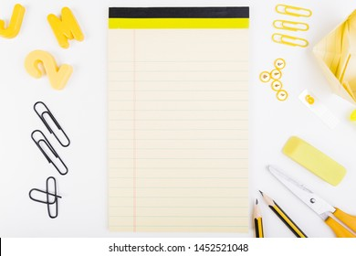 Blank sheet of paper with school supplies