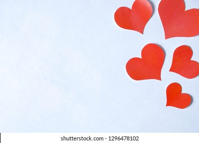Blank sheet of pure white decorated with hearts in right for writing a message.