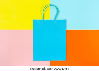 blank shopping bag on colorful paper, shopping concept or background