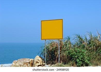 Blank sign against beautiful blue ocean.