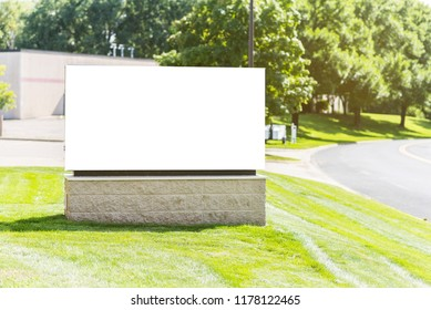 Blank sign by road quiet commercial area. White billboard with copy space during summer