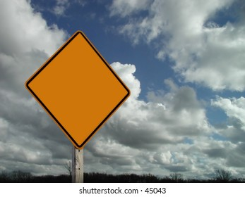 Blank sign with clouds