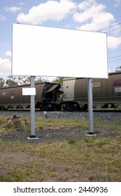 blank sign in front of train on move