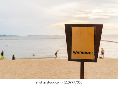 Blank sign label on the beach background.