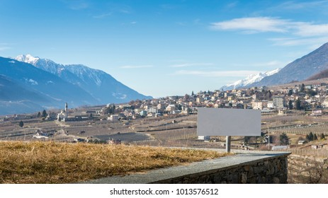 Blank sign overlooking vineyards above Sondrio, an Italian town and comune located in the heart of the wine-producing Valtellina region