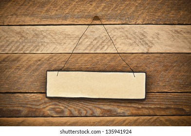 blank signboard on old  wooden wall